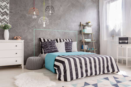 Shot of a modern bedroom interior with king size bed and white curtains Stock Photo