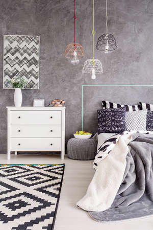 cropped shot: Cropped shot of a minimalist bedroom interior with a white chest of drawers