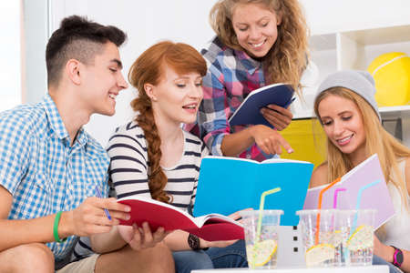 upcoming: Young students team making a revision to upcoming exam Stock Photo
