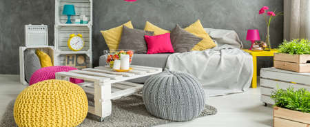 comfortable: Shot of a grey living room with colorful accessories Stock Photo
