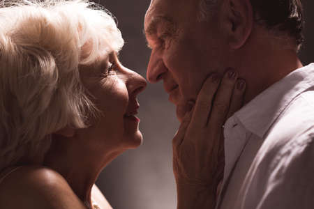Erotic senior couple looking with passion  at eyes Stock Photo