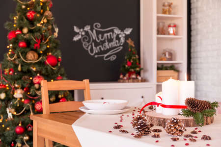 traditional christmas dinner: Modern flat with traditional Christmas dinner table decoration Stock Photo