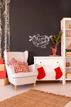 Contemporary Christmas living room with blackboard wall and white furniture