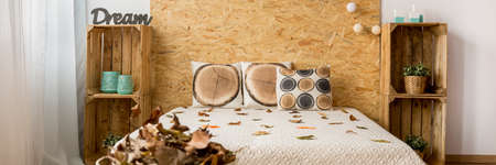 inspiring: Autumn leaves in eco and inspiring bedroom interior Stock Photo