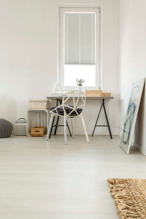 Light modern home office with window, simple desk and chair