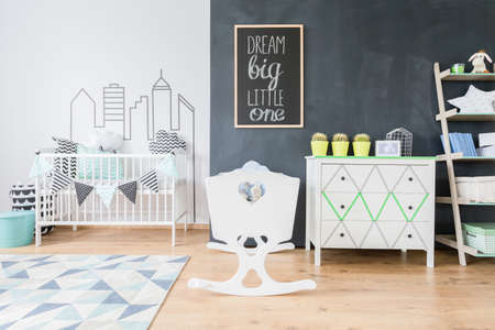room wall: Shot of a minimalist room for a baby boy with white wall decorated with washi tape Stock Photo