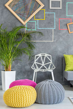 pouf: Modern colorful handmade poufs in grey living room Stock Photo