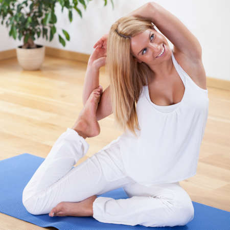 practicing: Image of woman in advanced yoga position Stock Photo