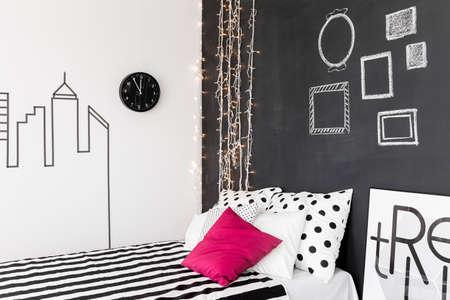 inspiring: Original inspiring bedroom interior with trendy blackboard wall Stock Photo