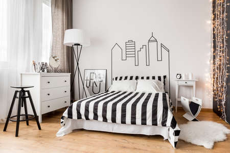 idea comfortable: Stylish spacious black and white female bedroom idea Stock Photo