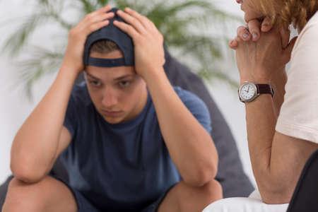 depressed person: Professional psychotherapist during psychotherapy session with depressed teenager