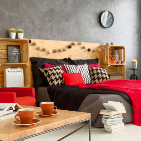 red color: Coffee cups on the table in modern bedroom