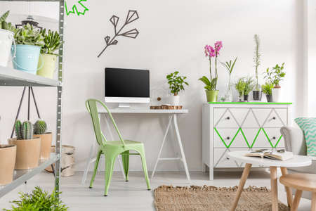 Bright room with home office area, commode and rack