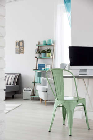 computer room: Shot of a pastel girls room with a minimalist place for work