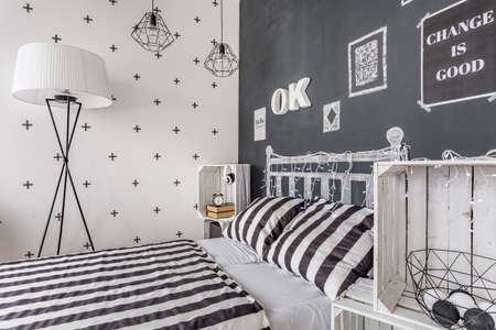 wall decoration: Shot of a bed in a black and white decorated bedroom Stock Photo