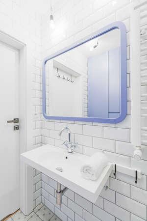 bathroom tiles: Minimalist bathroom with white tiles on the wall Stock Photo