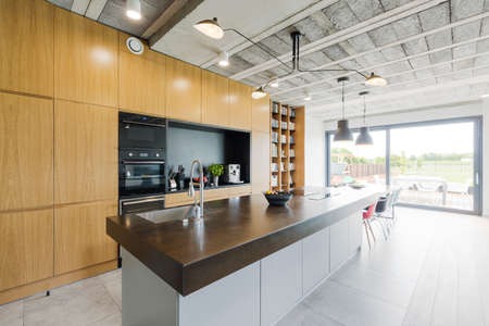 contemporary kitchen: Contemporary kitchen with island in modern style