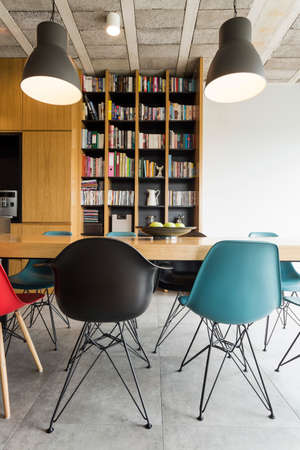 wood room: Modern interior with bookcase, table and contemporary chairs