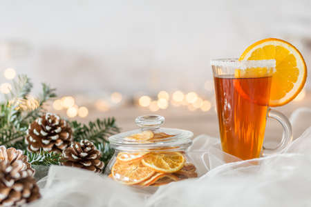 christmas tea: White winter composition with pine cones and glass of tea