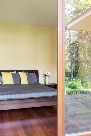 amenities: Bedroom with the marital bed with cushions and the patio entry