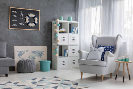 Contemporary style living room with nautical decor, trendy wall finish and comfortable armchair Stock Photo