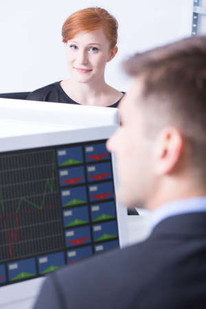 workmate: Woman looking at her workmate at the work office Stock Photo