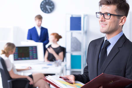 communicative: Work station with working employees and elegant businessman at the foreground