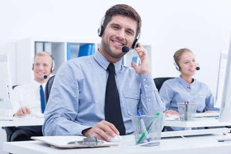 Businessman weraing headset, working in customer service department
