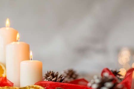 candela: Three white christmas candles isolated on a light background