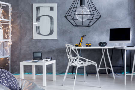 wall decor: Closer shot of home office area with minimalistic furniture and modern chandelier
