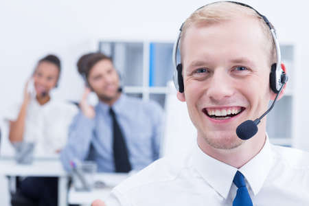 telemarketer: Portrait of happy and young telemarketer wearing headset Stock Photo