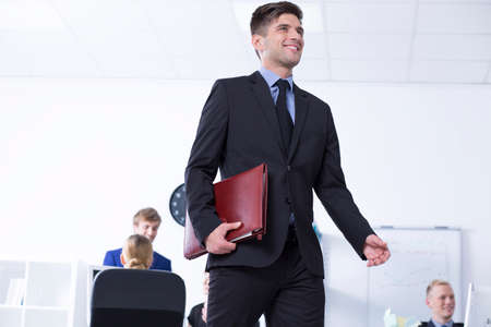 communicative: Work open space area with the elegant man keeping his briefcase Stock Photo