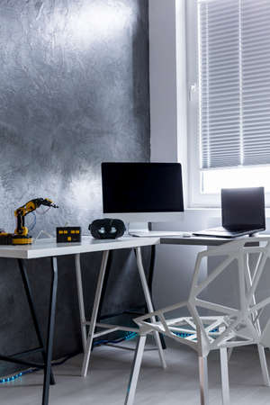 home office interior: Interior with the cyan wall, window and home office area with desk and chair