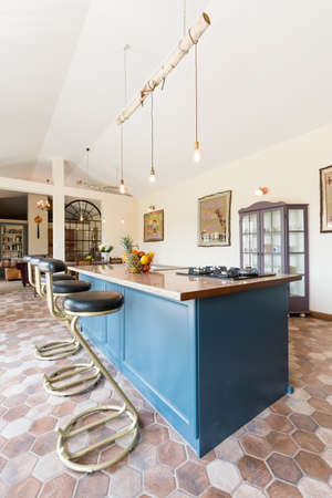 muebles de madera: Spacious renovated old-fashioned kitchen with wooden blue furniture Foto de archivo