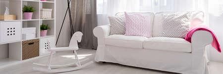 white sofa: Panorama of white sofa in baby room Stock Photo