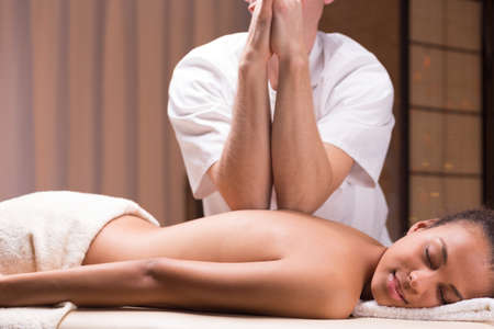 Male professional masseur doing deep tissue massage