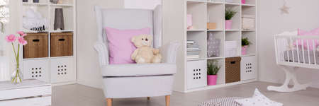 comfort room: Close-up of modern armchair in nursery room