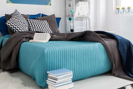 comfortable: Comfortable bed in cozy modern blue bedroom Stock Photo