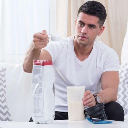 dietetic: Man preparing his dietetic cocktail and measuring the components ratio Stock Photo