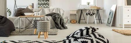 minimalistic: White room interior with modern and minimalistic furniture