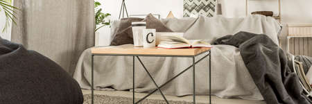 messy room: Minimalistic coffee table in a messy room interior