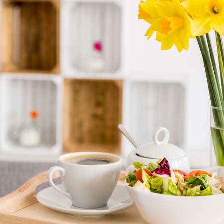 Cup of coffee and salad - breakfast in bed