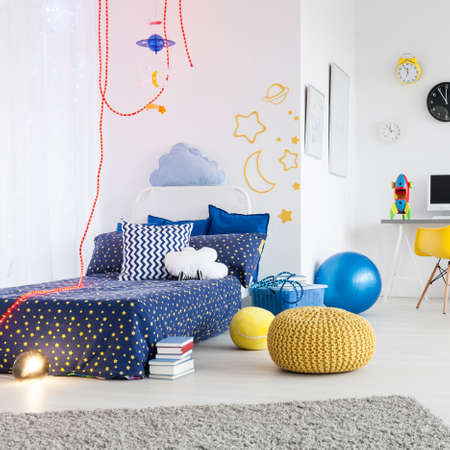 Bright and spacious child room divided into a work area and area to sleep