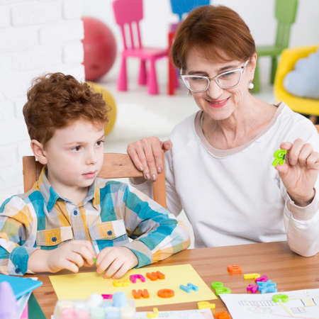 articulation: Young boy participating in speech therapy session