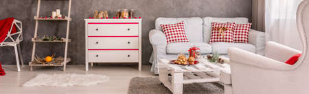 christmassy: Well-lighted room with commode, couch and Christmassy motives Stock Photo