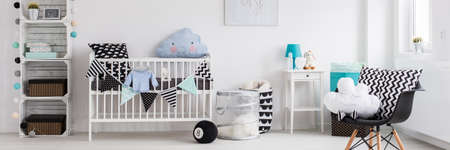 babys: Stylish modern decor of babys room. White cradle and shelf in the middle of white interior