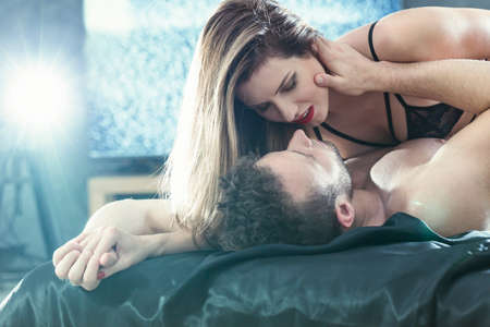 kisses: romance in bed of virtual attractive lovers Stock Photo