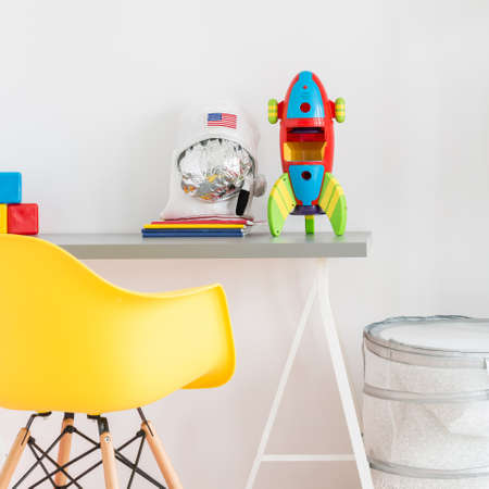Part of a cool teenager room with desk and chair Stock Photo