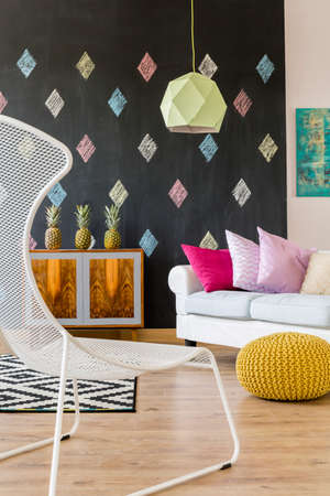 black carpet: Living room in exotic style, modern lamp and white and black carpet