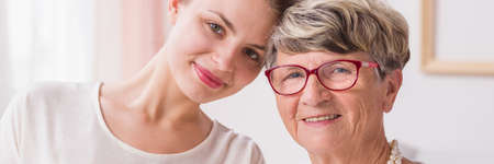 Portrait of a young woman and positive senior lady, panorama Stock Photo
